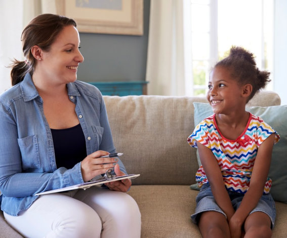 a therapist and a child smiling at each other