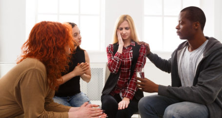 a group of people having a therapy session