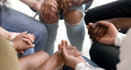a group of people holding each other's hands