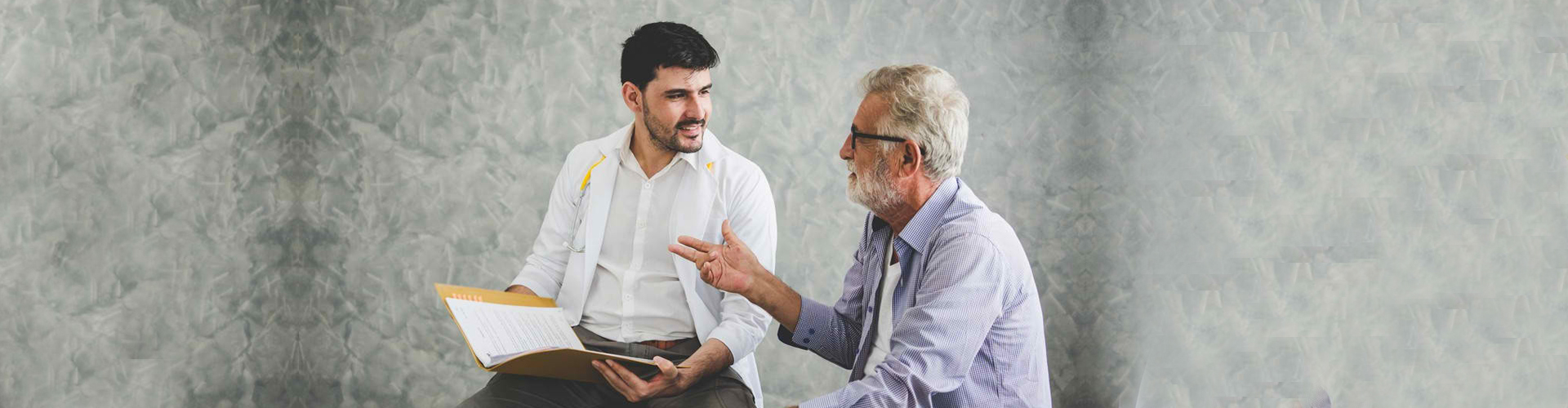 a senior man talking with his therapist