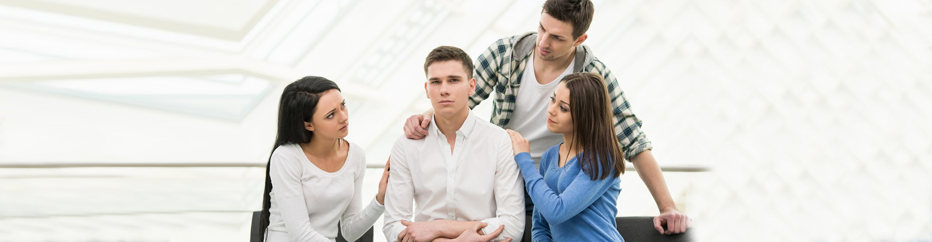 a man crying and is being comforted by his peers